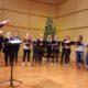 Chris Quinn plays to a choir of donors