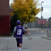 Injured lacrosse player returns to the turf
