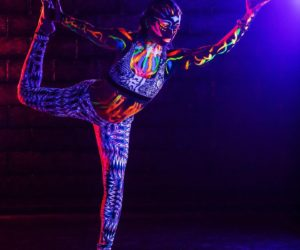 Glow-in-the-dark paint and yoga gives yogis more freedom and self-exploration