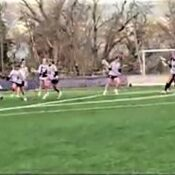 Westminster Lacrosse team plays on the field.