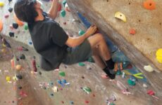 Noah Drake Duval participates in the self-scored bouldering competition April 8.